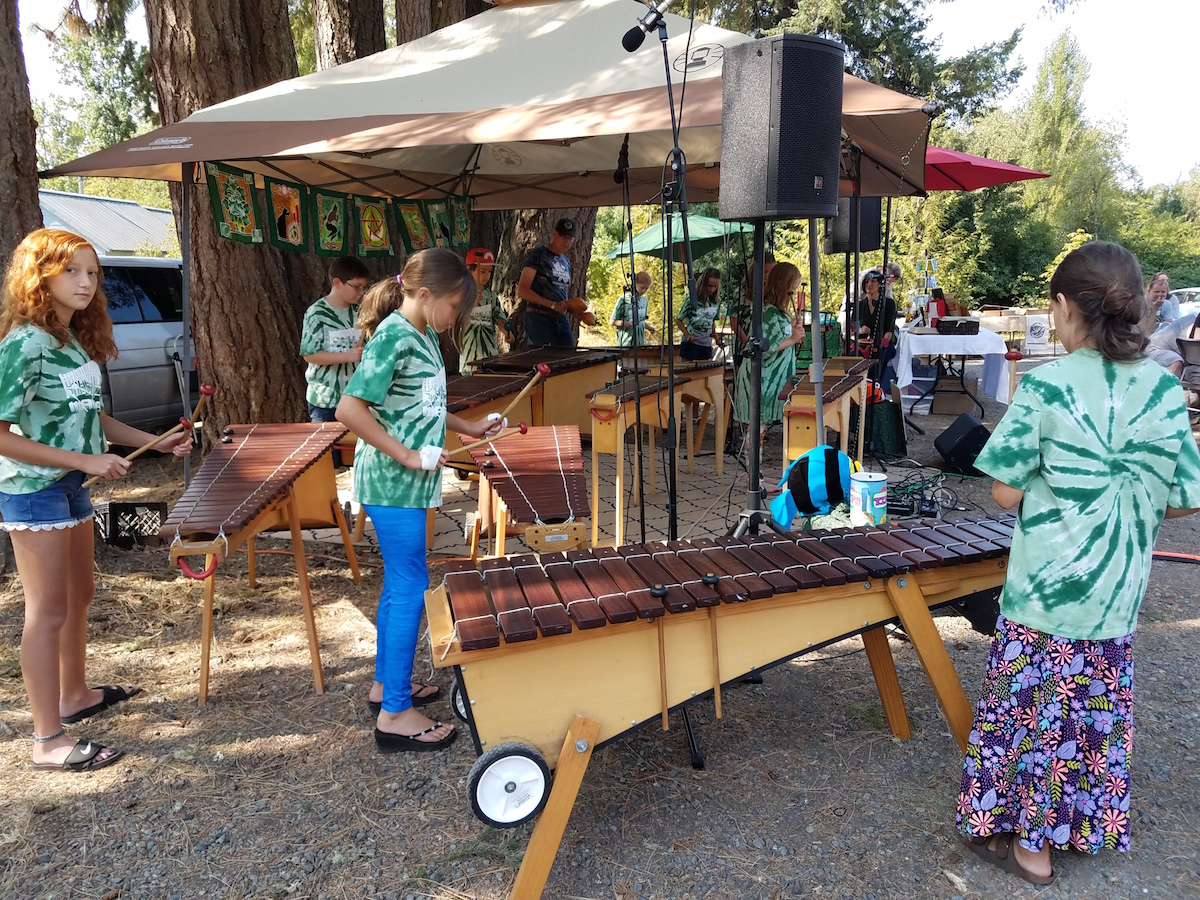 Adams Elementary School Marimba Band performing at the Spencer Creek Market