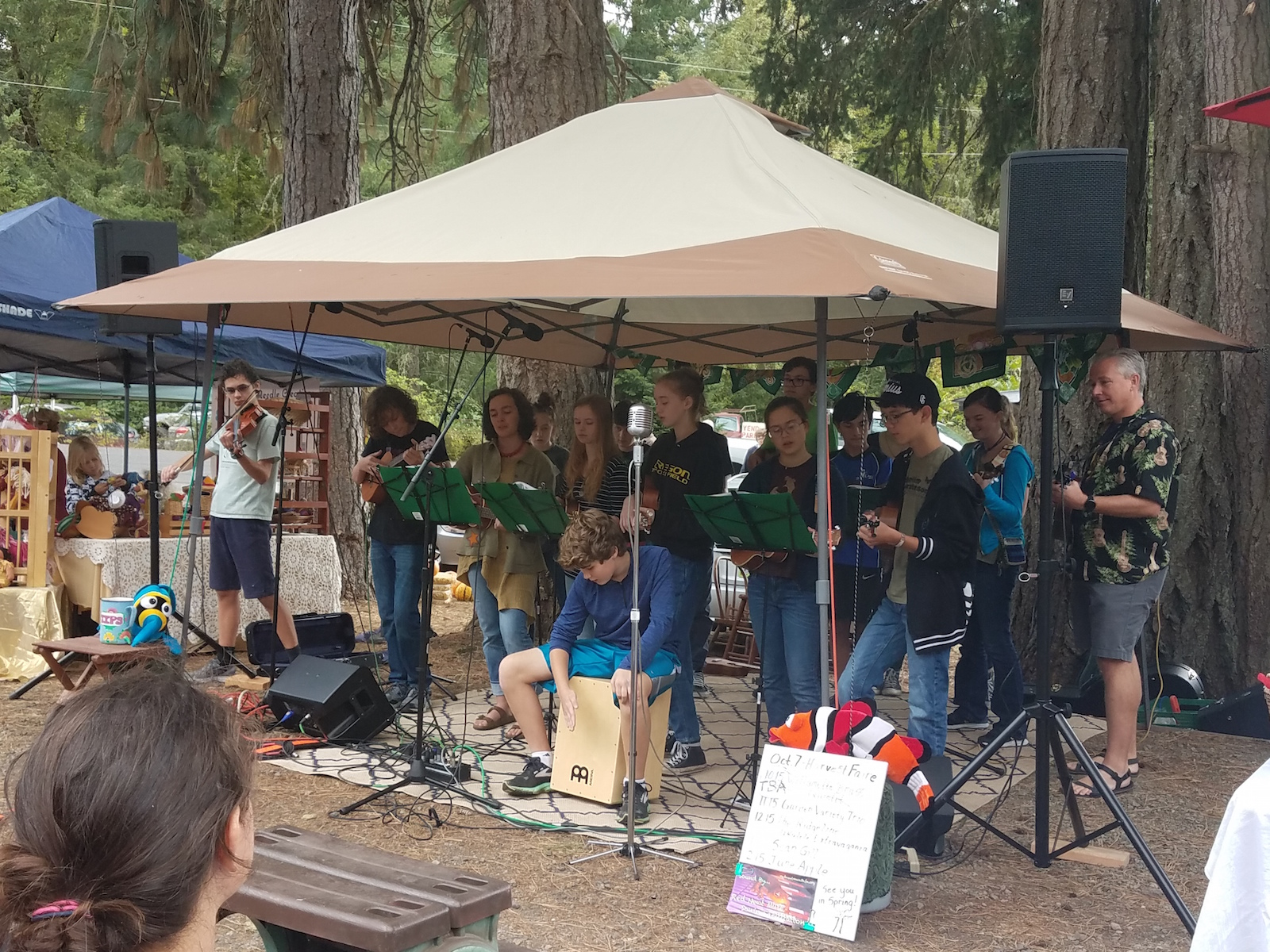 TRUE perform during the 2017 Harvest Fair at the Spencer Creek Growers Market